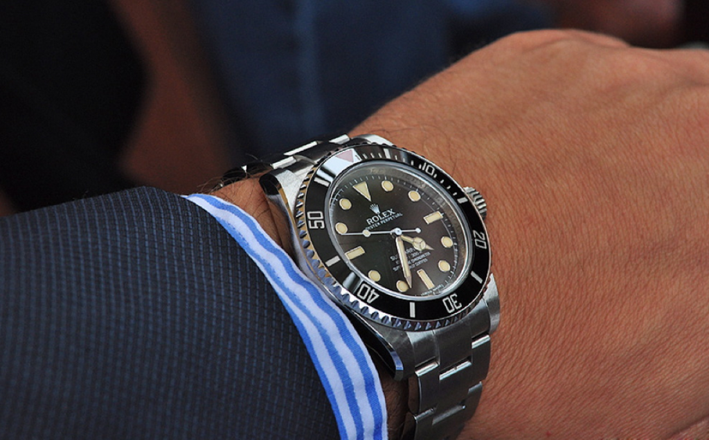rolex-submariner-114060-dive-watch-on-hand-with-sleeve