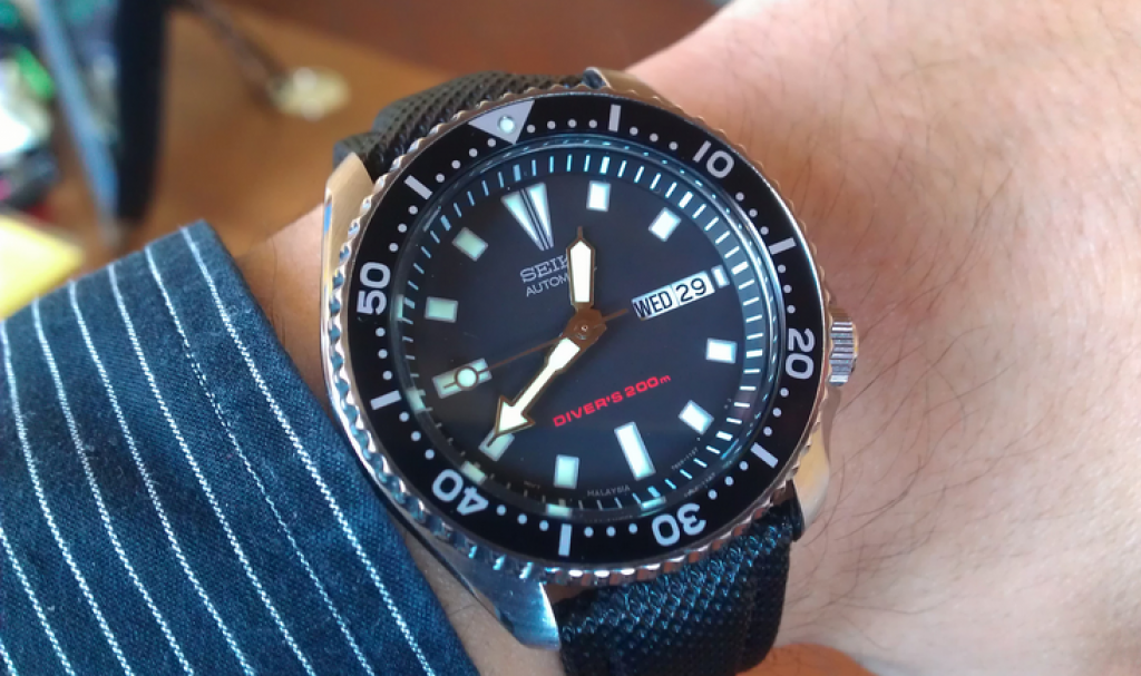 seiko-mens-skx173-dive-watch-on-hand-with-sleeve