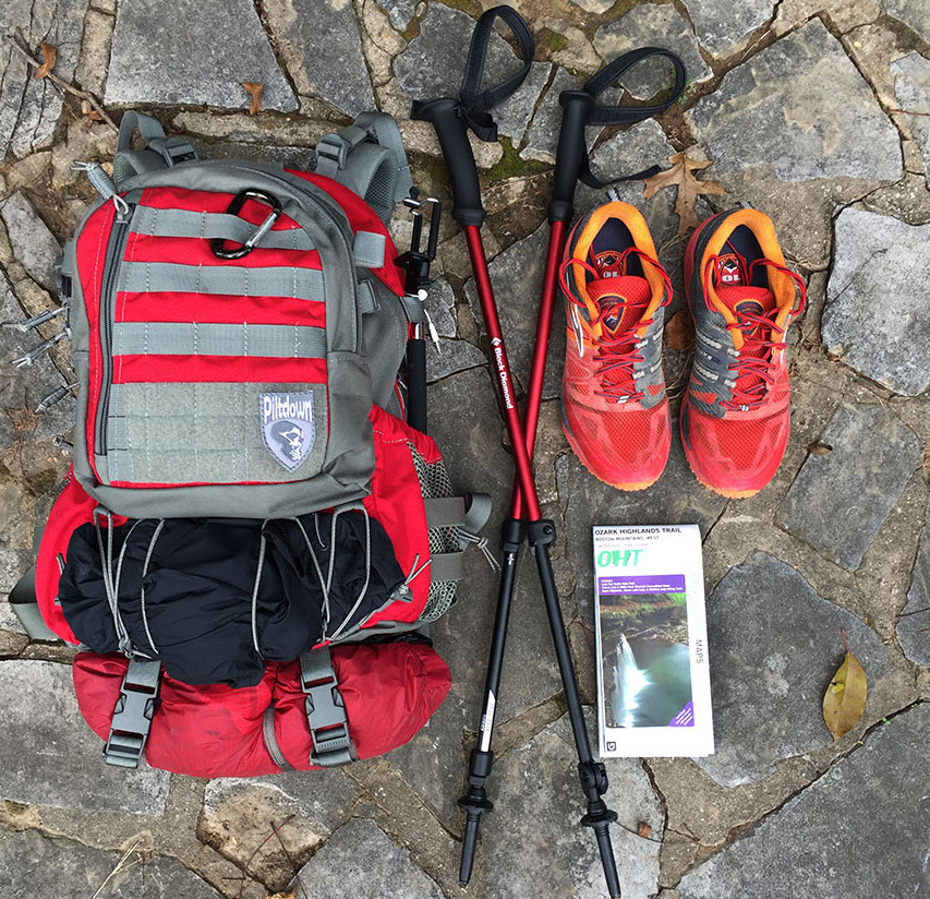 hiking backpack sticks and shoes plus maps
